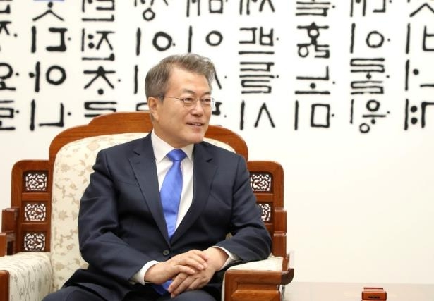 a man wearing a suit and tie: South Korean President Moon Jae-in attends a meeting with North Korean leader Kim Jong Un at the Peace House