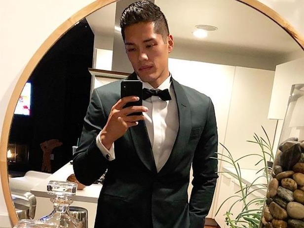 a man wearing a suit and tie: tim chung kylie jenner bodyguard