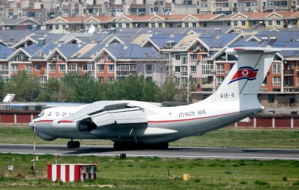 a plane sitting on top of a runway: A plane from the North Korean carrier Air Koryo in Dalian, China, on Tuesday. The presence of the plane prompted early speculation that North Korea's leader was visiting China again.
