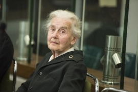 a man wearing a suit and tie: A 'Nazi Grandma' has been caught after not turning up to her prison sentence.