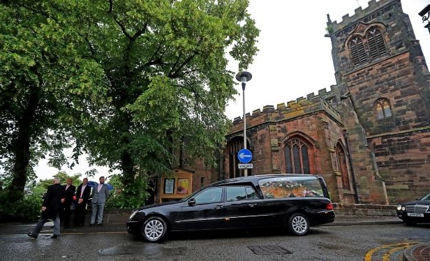 The coffin of Nell Jones, 14, who was killed in the Manchester Arena bombing, arrives at Saint Michaels and All Angels Church in Middlewich, Cheshire, for her funeral service.