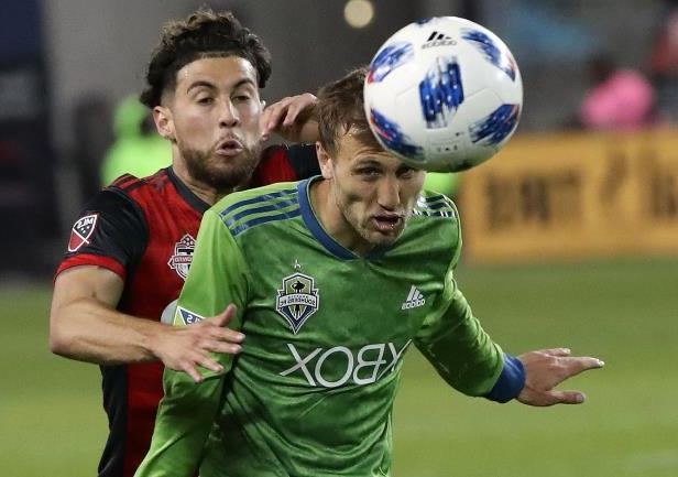 Seattle midfielder Magnus Eikrem TFC's Jonathan Osorio battle for the ball in the Sounders' 2-1 win at BMO Field. Osorio scored Toronto's lone goal.