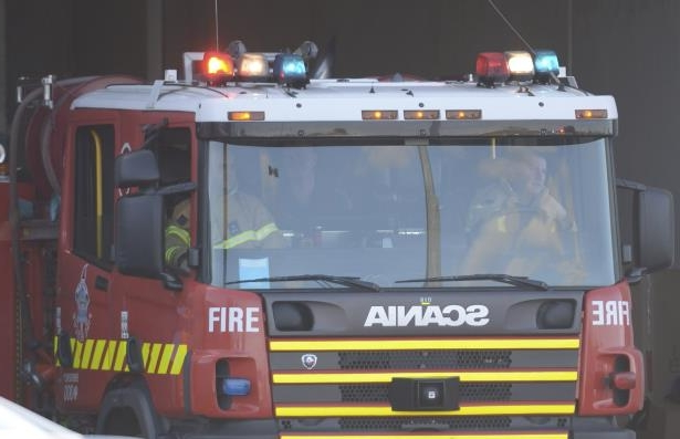 A Sydney volunteer firefighter failed to stop before making a U-turn which allegedly caused a fatal freeway crash, a court has heard.
