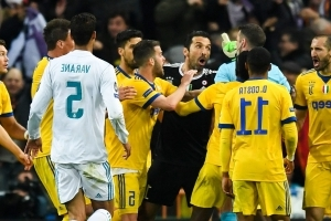 Buffon charged over Michael Oliver comments