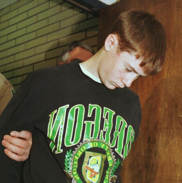 FILE - In this May 22, 1998, file photo, Thurston High School student Kip Kinkel, 15, is led to his arraignment in Eugene, Ore. Kinkel has lost an appeal to the Oregon Supreme Court, Thursday, May 10, 2018, where he had sought reduction of the 111-year sentence he received for the 1998 mass shooting at his high school. (AP Photo/Don Ryan, file)