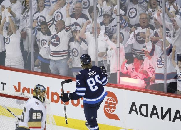 Winnipeg Jets' Patrik Laine (29) celebrates his goal on Vegas Golden Knights goaltender Marc-Andre Fleury (29) during the first period of Game 1 of the NHL hockey playoffs Western Conference final, Saturday, May 12, 2108, in Winnipeg, Manitoba. (John Woods/The Canadian Press via AP)