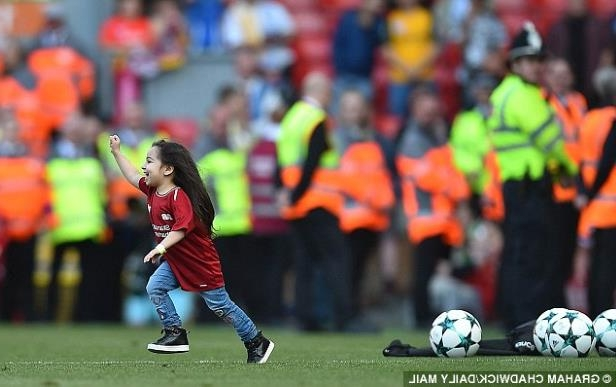 a crowd of people watching a football ball: The Anfield crowd took to her immediately and cheered as Salah Jnr showed off her skills