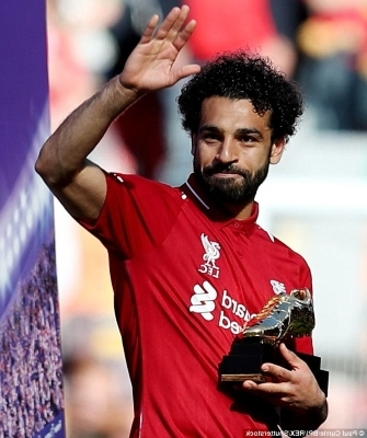 Mohamed Salah talking on a cell phone: The 25-year-old picked up the Premier League Golden Boot after Liverpool's win over Brighton