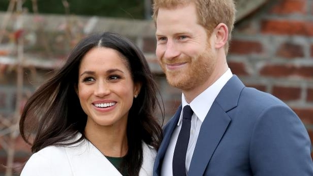 Prince Harry, Meghan Markle posing for the camera
