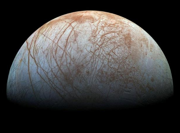 a close up of a logo: Handout photo of a view of Jupiter's moon Europa, created from images taken by NASA's Galileo spacecraft in the late 1990's
