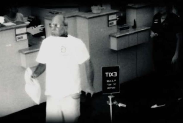 a man standing in a kitchen: Camera footage of Brian Wells at PNC Bank in Erie, Pennsylvania