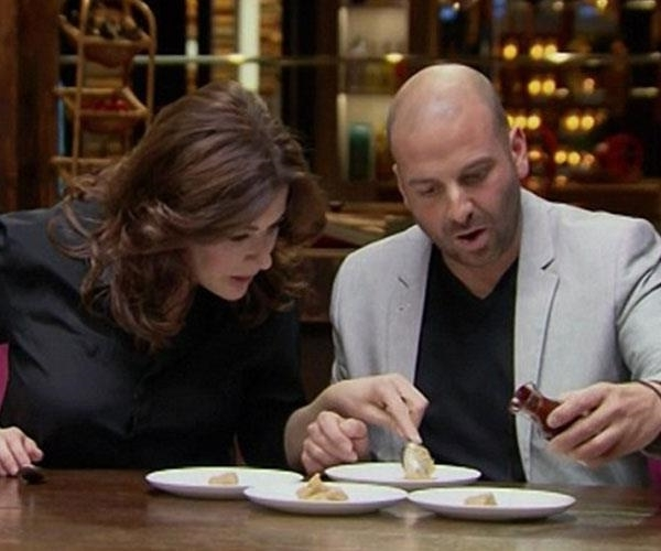 a person sitting at a table with a knife and fork: Nigella (right) with MasterChef Australia judge George.