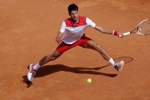 Djokovic, Nishikori advance to second round in Rome