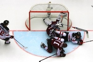 McDavid scores in overtime as Canada squeaks out 2-1 win over Latvia