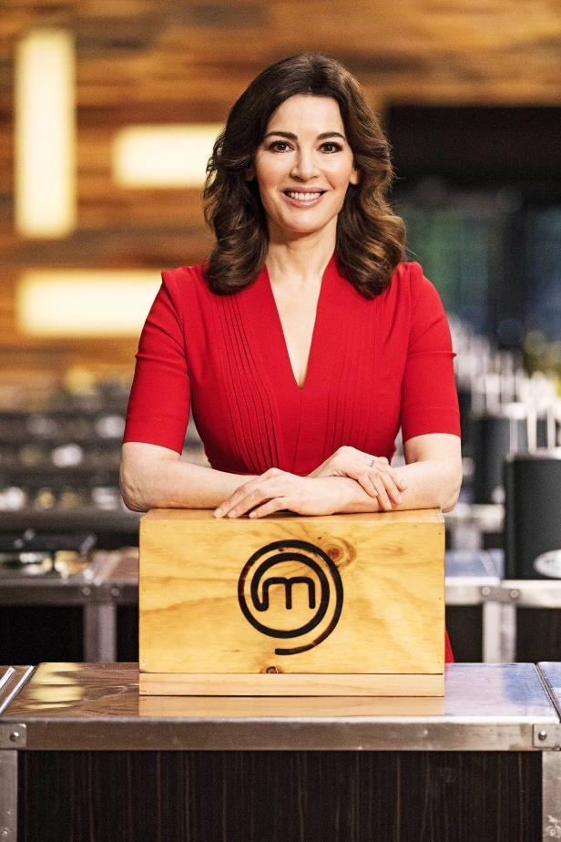 Nigella Lawson standing in front of a building: Nigella reveals she's just 'not the kind of person' who would compete on MasterChef Australia.