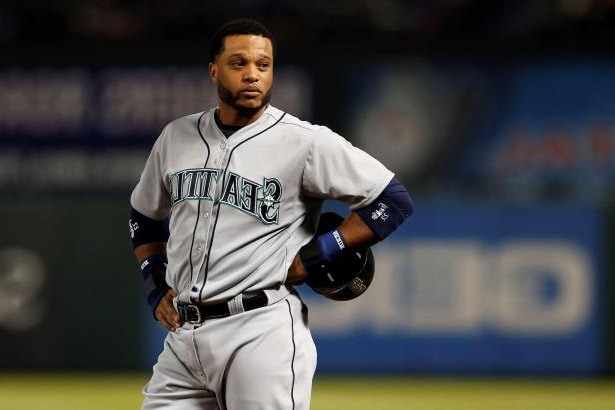 Seattle Mariners' Robinson Cano stands on third during a baseball game against the Texas Rangers Wednesday, April 29, 2015, in Arlington, Texas.