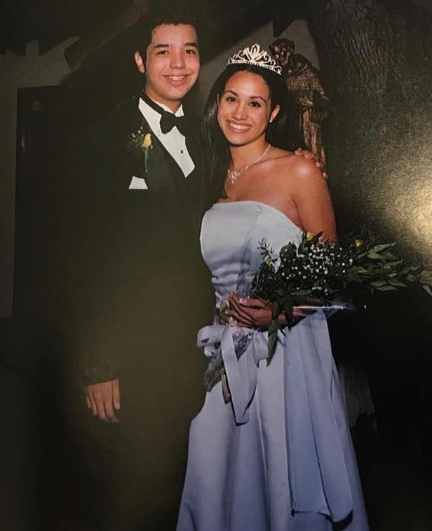 Slide 2 of 21: Markle was crowned homecoming queen at the age of 17. She wore a strapless blue gown and sparkling tiara to prom with her date, a young man from the nearby St. Francis High School.