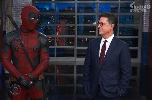 a man standing in front of a building: Late Show: Jamie Foxx Guests; Deadpool Crashes Monologue