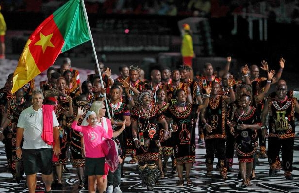 Cameroon's flagbearer Essiane Clotilde leads the delegation during the opening ceremony of the 2018 Gold Coast Commonwealth Games
