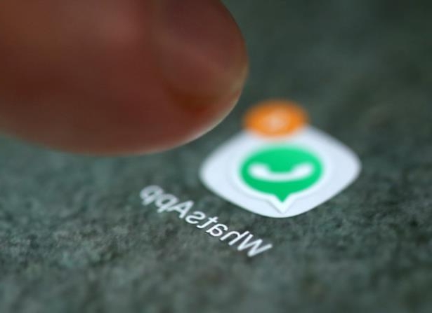 FILE PHOTO: The WhatsApp app logo is seen on a smartphone in this illustration