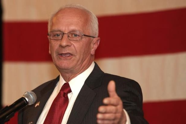 Kerry Bentivolio wearing a suit and tie