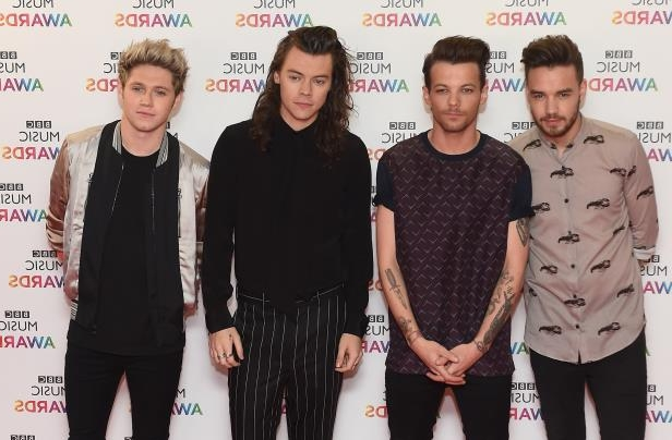 (left to right) Liam Payne, Louis Tomlinson, Harry Styles and Niall Horan of One Direction arrive on the red carpet for the BBC Music Awards at the Genting Arena, Birmingham.