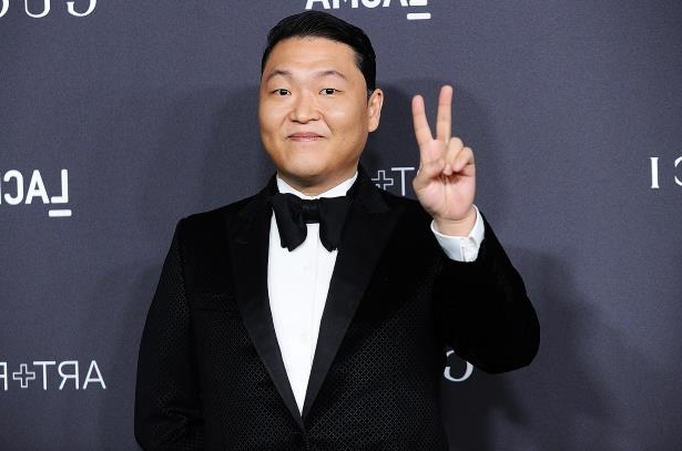 Psy wearing a suit and tie: PSY attends the 2016 LACMA Art + Film gala at LACMA on Oct. 29, 2016 in Los Angeles.