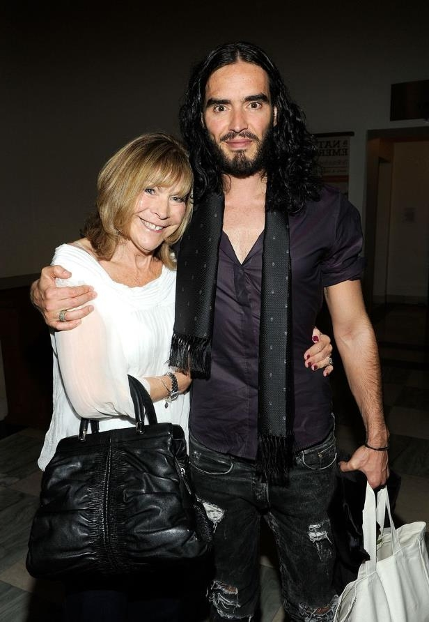 Russell Brand et al. posing for the camera: Russell Brand, and mother Barbara Brand