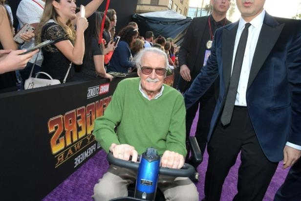 Stan Lee et al. posing for the camera: Stan Lee at the Avengers: Infitiy War premiere in Los Angeles.