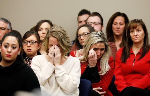 Victims and others look on as Rachael Denhollander speaks at the sentencing hearing for Larry Nassar, a former team USA Gymnastics doctor who pleaded guilty in November 2017 to sexual assault charges, in Lansing, Michigan, U.S., January 24, 2018.