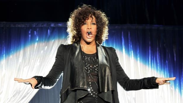 Whitney Houston smiling for the camera