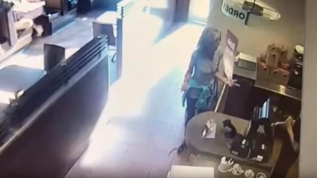 a close up of a machine: This screen capture from a video posted online appears to show a woman arguing with restaurant staff before she defecated in front of the counter and threw it at staff.