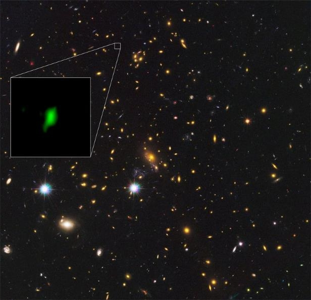 a green traffic light at night: Hubble Space Telescope image of the galaxy cluster MACS J1149.5+2223 and ALMA image of the galaxy MACS1149-JD1 located 13.28 billion light-years away