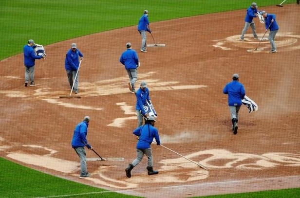 a group of people playing a game of baseball