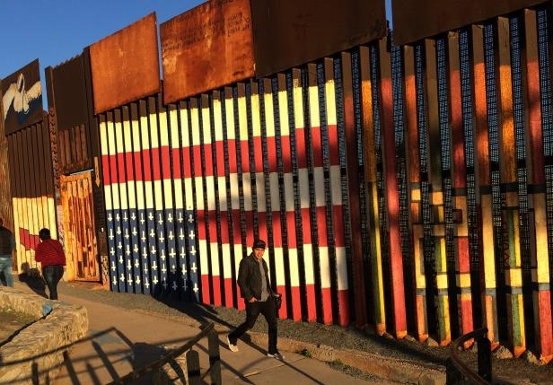 For years a flag mural at the border has honored deported U.S. military veterans. After Trump visit, agents are looking into taking it down.