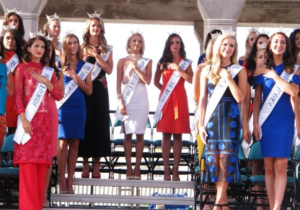 In this Aug. 30, 2017 photo contestants attend a welcoming ceremony for the Miss America competition on the Atlantic City, N.J., Boardwalk. On Thursday, May 17, 2018, the Miss America Organization announced it has installed women in the organization's three top leadership posts following an email scandal last winter involving male leaders. (AP Photo/Wayne Parry)