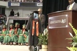 iPad in cap and gown stands in for hospitalized girl at graduation