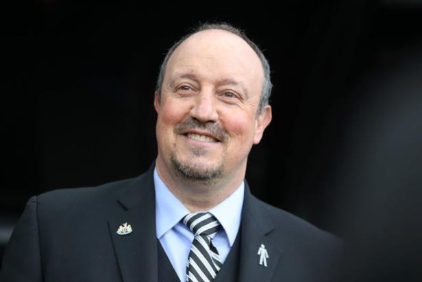 Rafael Benitez wearing a suit and tie smiling at the camera: Ian MacNicol/Getty Images Sport