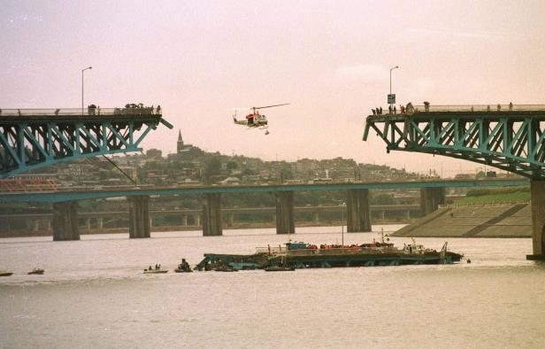 Slide 4 of 13: A helicopter flies above the collapsed section of the Sungsu bridge over Seoul's Han River in this Oct. 21, 1994 file photo. The bridge that collapsed during morning rush hour three years ago, killing 32 commuters and schoolchildren was reopened Thursday, July 3, 1997 after being rebuilt.