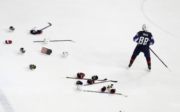 Patrick Kane of the United States stands on the ice after defeating Canada 2-1 in the Ice Hockey World Championships bronze medal match between Canada and the United States at the Royal arena in Copenhagen, Denmark, Sunday, May 20, 2018. (AP Photo/Petr David Josek)