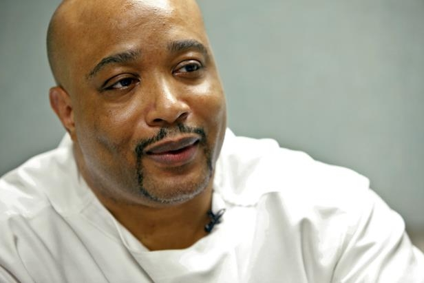 Offbeat: Ohio inmate claims innocence in slaying of 3, wants