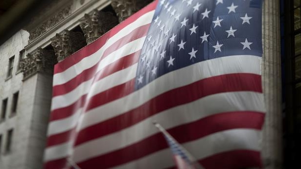 The American flag is hung on the exterior of the New York Stock Exchange (NYSE) in New York.
