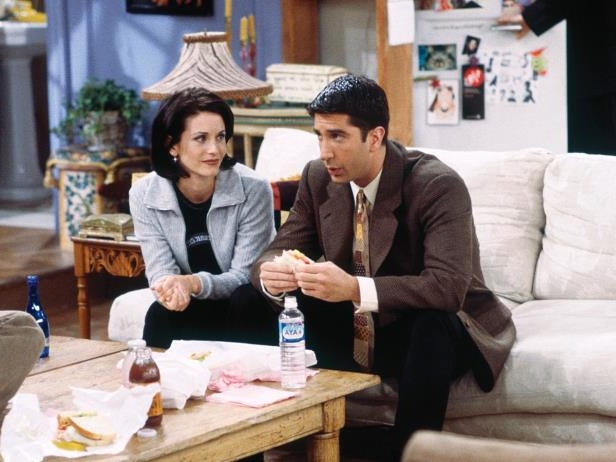 David Schwimmer, Courteney Cox sitting at a table: Refinery29