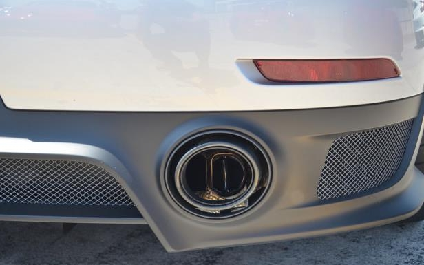 Slide 15 of 24: 2018 Porsche 911 GT2 RS - Titanium exhaust system with flaps to alter the sound of the engine.