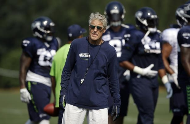 Seattle Seahawks head coach Pete Carroll in action during an NFL football training camp Friday, Aug. 4, 2017, in Renton, Wash. (AP Photo/Elaine Thompson)
