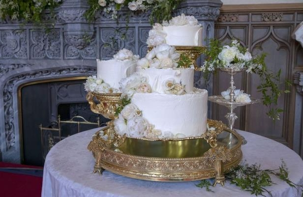 a large white cake sitting on top of a table: royal wedding cake