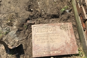Is there a body in my backyard? Woman unearths gravestone while gardening