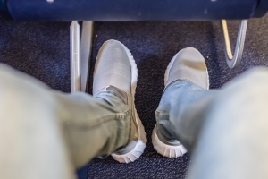 Why You Should Never Take Your Shoes Off On an Airplane