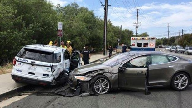 799f95a3c4 a car parked in a parking lot  The scene of the accident involving a Tesla