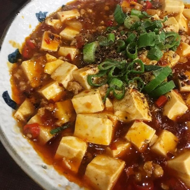 "a pizza sitting on top of a plate of food: @matsuken75 on Instagram: ""Chinese Food ③ #chinesefood #chinese #chineserestaurant #cibocinese #ristorantecinese #maohunan #tofu #spicytofu #tofupiccante #spicy…"""